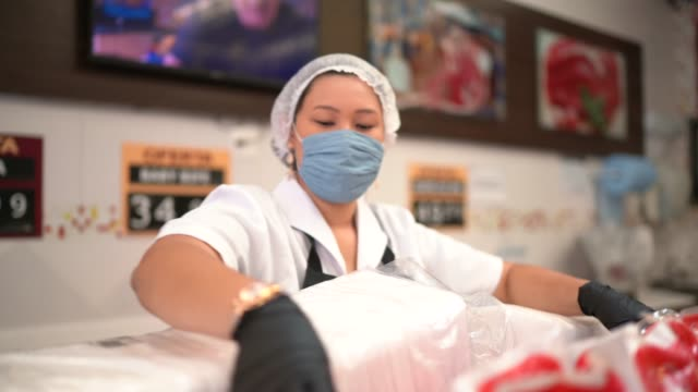 female butcher walking and working at butcher's shop - gender stereotypes stock videos & royalty-free footage