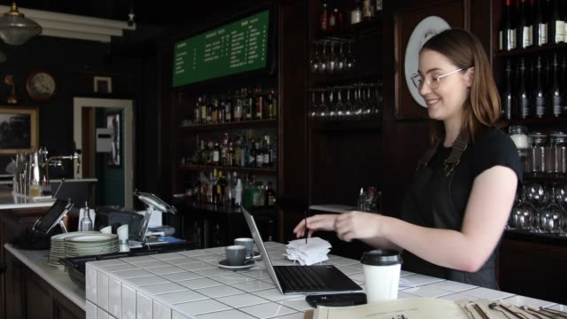 female cafe owner doing accounts - manager stock videos & royalty-free footage