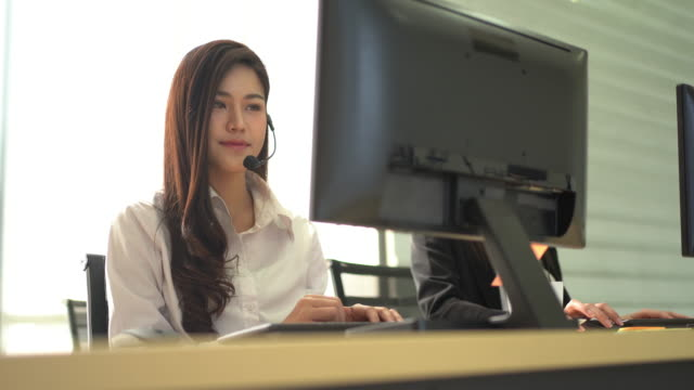female call center operator working with headset - cross section stock videos & royalty-free footage