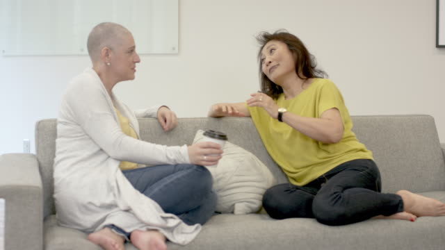 female cancer patient having tea with a friend - chronic illness stock videos and b-roll footage