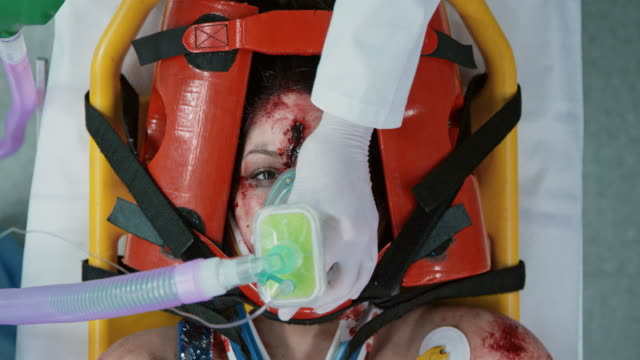 Female car crash victim being prepared for an emergency surgery