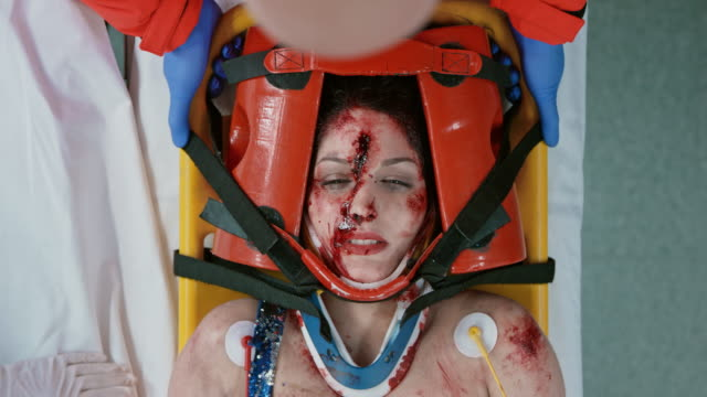 Female car crash victim receiving an anesthetic through a face mask