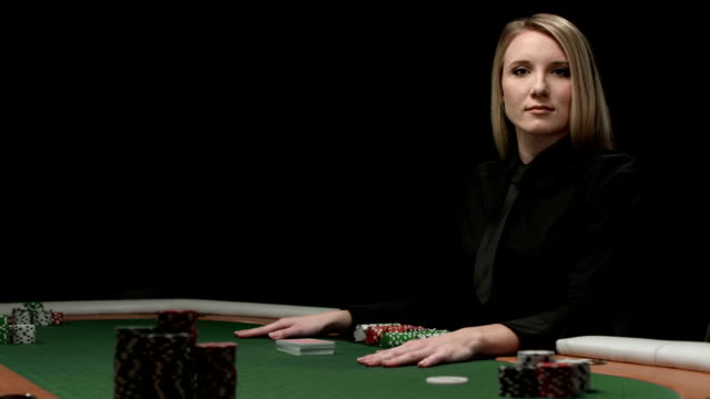 hd dolly: female card dealer - gambling chip stock videos and b-roll footage