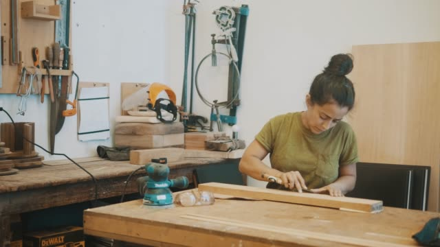 Female carpenter at work (slow motion)