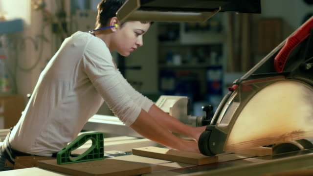 female carpenter in workshop - carpenter stock videos & royalty-free footage