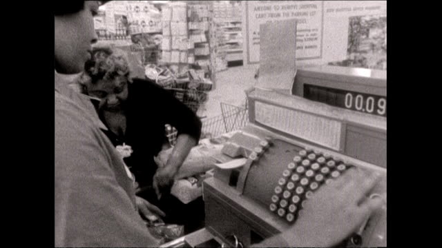 female cashier rings up purchases in supermarket - customer stock videos & royalty-free footage