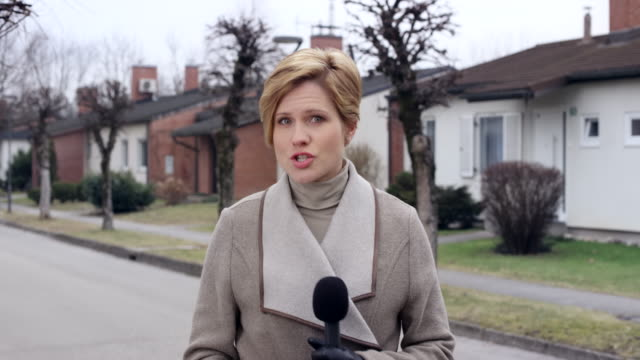 Female Caucasian on the scene news reporter answering questions from the studio
