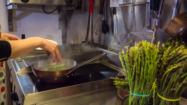 cu female chef preparing food in restaurant kitchen - boiled stock videos and b-roll footage