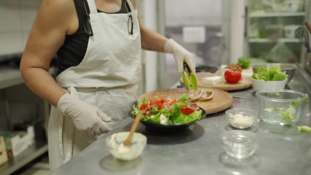 female chef preparing healthy salad at commercial kitchen - feta stock videos & royalty-free footage