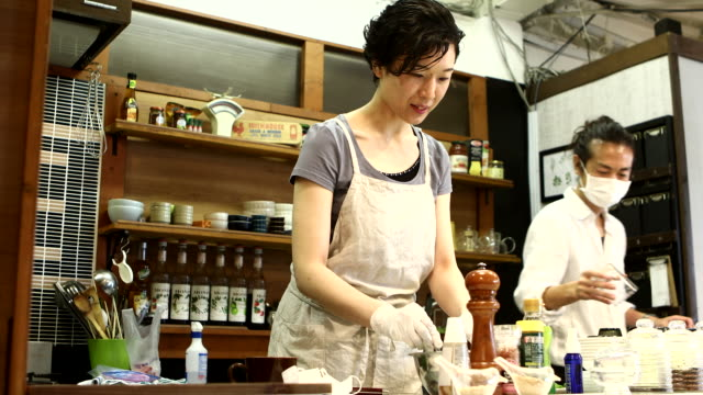 a female chef reopens for business and tastes the food - tasting stock videos & royalty-free footage