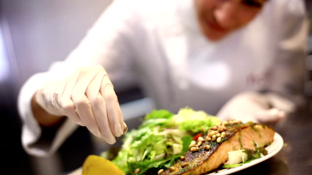 Female chef serving a meal.