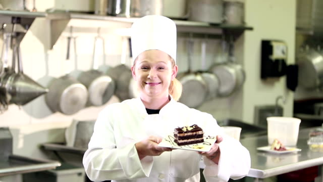 female chef with slice of cake - entrepreneur stock videos & royalty-free footage