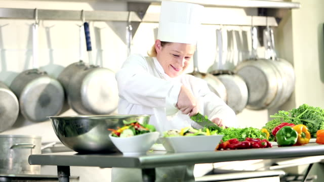 female chef working in commercial kitchen - caterer stock videos and b-roll footage