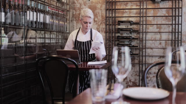 female chef working on digital tablet in restaurant - gastwirt stock-videos und b-roll-filmmaterial