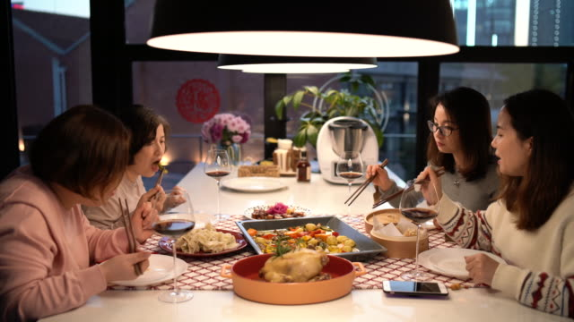 female chinese friends having dinner at home - chinese culture stock videos & royalty-free footage
