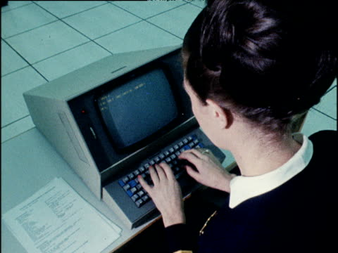 female clerk typing on old fashioned computer launch of new boadicea system for use by airline industry; 07 nov 68 - desk stock videos & royalty-free footage