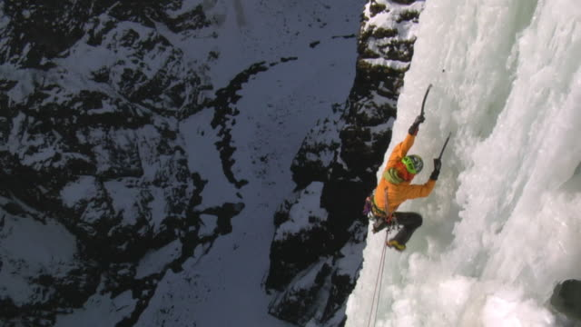 ws ha zi cu female climber climbing ice wall, eidfjord, hordaland, norway - climbing wall stock videos & royalty-free footage