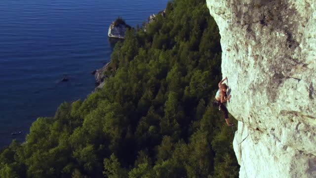 ws ha female climber climbing rock, falling and holding onto rope, lion's head, ontario, canada - climbing rope stock videos & royalty-free footage
