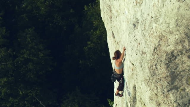 ws ha td female climber climbing rock, falling and holding onto rope, lion's head, ontario, canada - climbing rope stock videos & royalty-free footage