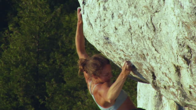 ms female climber climbing rock, lion's head, ontario, canada - one young woman only stock videos & royalty-free footage
