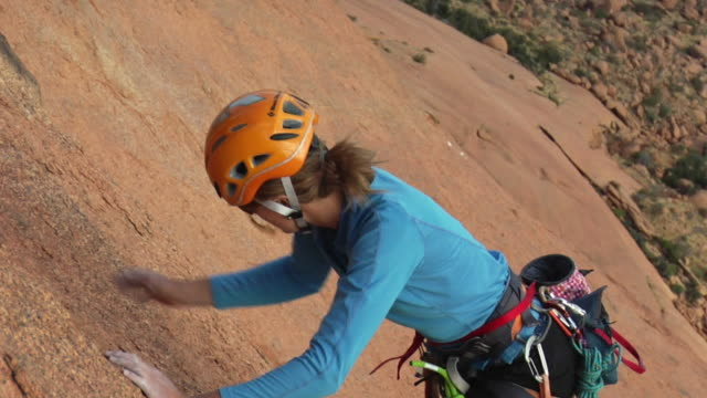 ws zi zo ms ha female climber climbing rock, spitzkoppe, damaraland, namibia - sports helmet stock videos and b-roll footage