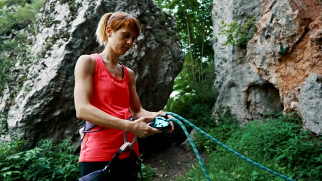 female climber preparing for climbing - krab stock videos & royalty-free footage