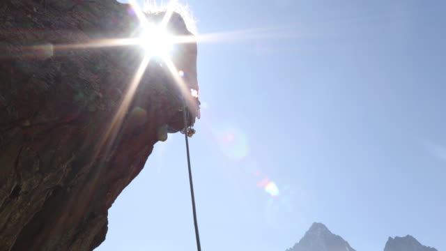 female climber struggles to ascend steep rock cliff - rope stock videos & royalty-free footage