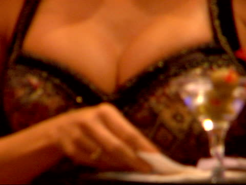 * female cocktail server body in revealing teddy body suit uniform carrying tray of alcoholic beverages placing martini drink on gaming table male... - waitress stock videos & royalty-free footage