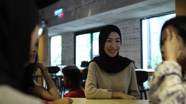 female colleagues having coffee break in cafe - indonesian ethnicity stock videos & royalty-free footage
