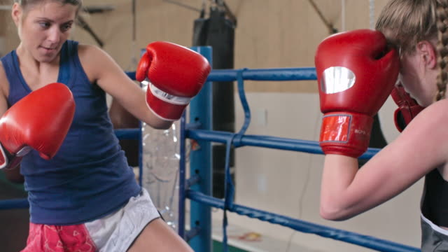 Female combat athlete doing kicks