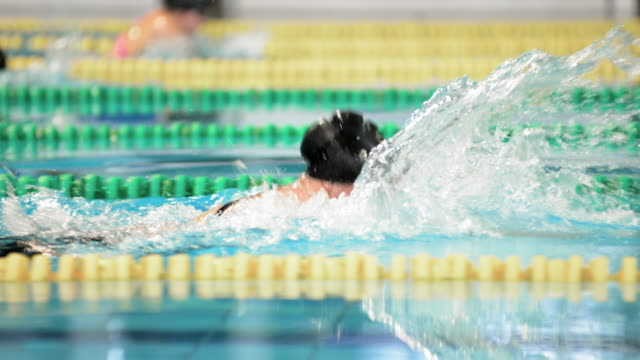 SLO MO TS Female competing in breaststroke swimming competition