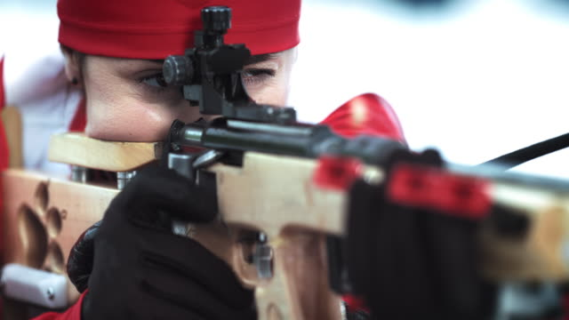 female competitor taking shots in a biathlon race - biathlon stock videos and b-roll footage