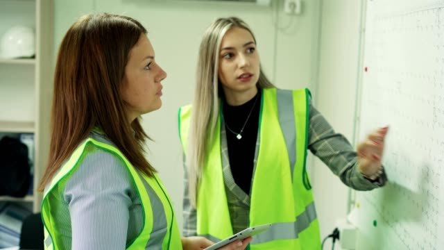 female construction engineers in the office - occupational safety and health stock videos & royalty-free footage