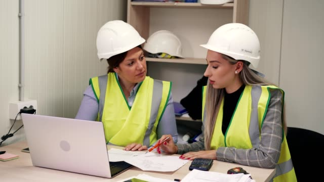 female construction engineers in the office - two people stock videos & royalty-free footage
