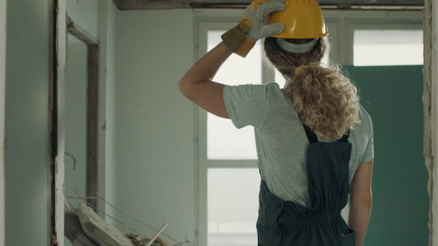 female construction worker contemplating on construction site - new stock videos & royalty-free footage