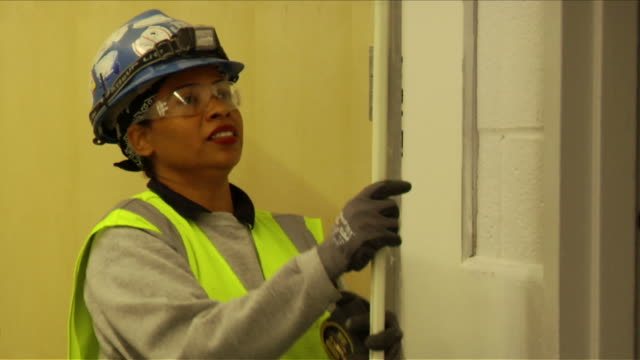 female construction worker with male colleagues on april 30 2012 in washington dc - stereotypically working class stock videos and b-roll footage