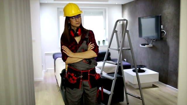 female construction worker with tools - tool belt stock videos and b-roll footage