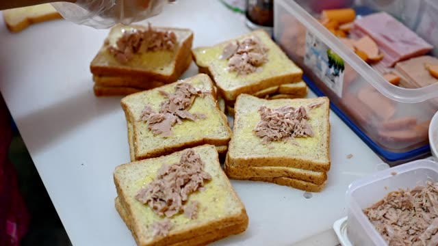 female cook making a sandwich with butter wheat bread and tuna, sausage, crab stick - stuffed stock videos & royalty-free footage