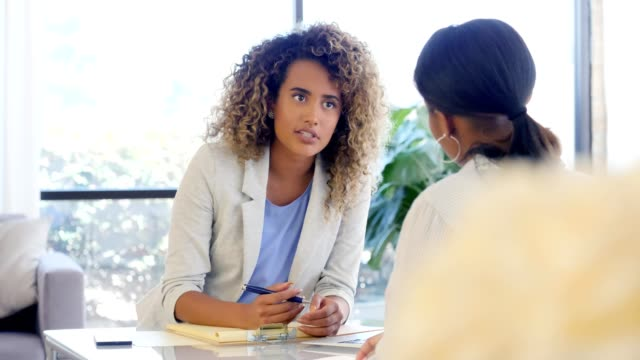 female counselor discusses a client's progress - job interview stock videos & royalty-free footage