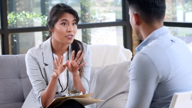 female counselor gestures to patient as she speaks. - psychiatrist's couch stock videos & royalty-free footage