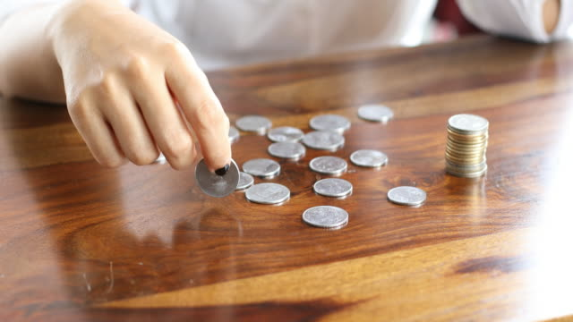 female counting money - coin stock videos & royalty-free footage