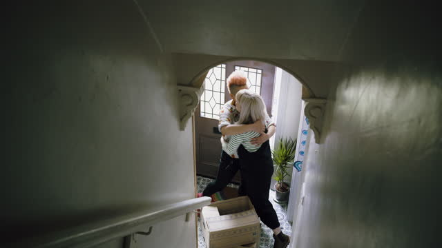 female couple hug in hallway of new home - image stock videos & royalty-free footage