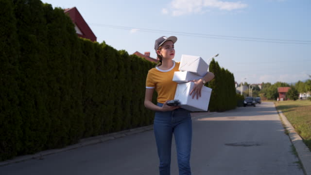 female courier cant find a right house - man made object stock videos & royalty-free footage