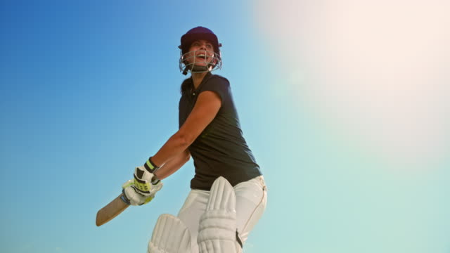 slo mo female cricket player hitting the ball with her bat in sunshine - cricket ball stock videos & royalty-free footage