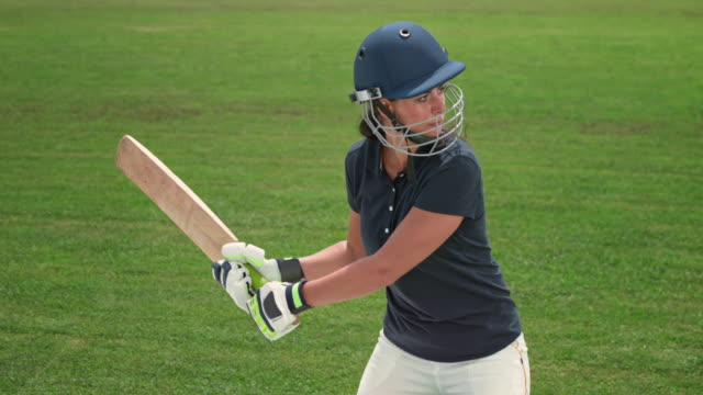 slo mo female cricket player hitting the ball with her bat - cricket ball stock videos & royalty-free footage
