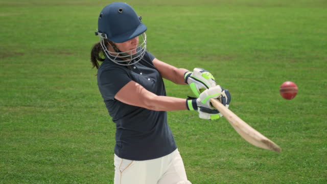 slo mo speed ramp female cricket player hitting the ball with her bat - cricket ball stock videos & royalty-free footage