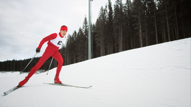 slo mo female cross country athlete in a race - pokljuka stock videos and b-roll footage