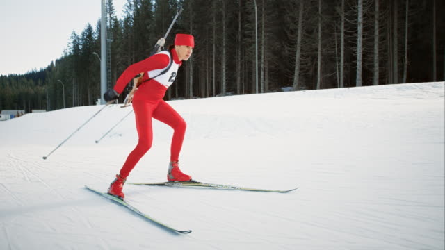 SLO MO female cross country skiing competitor