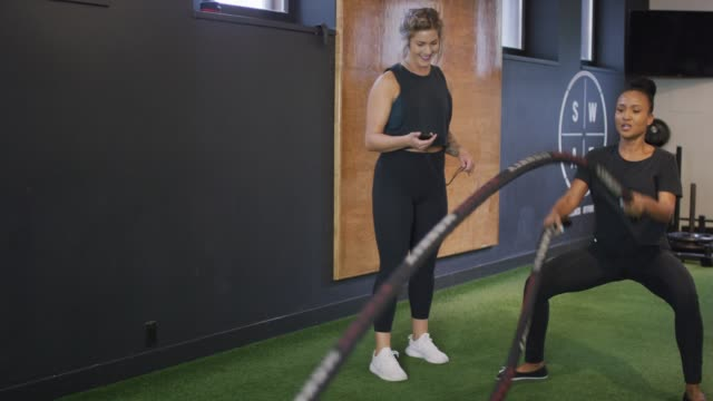female cross training coach and athlete - exercise class stock videos & royalty-free footage