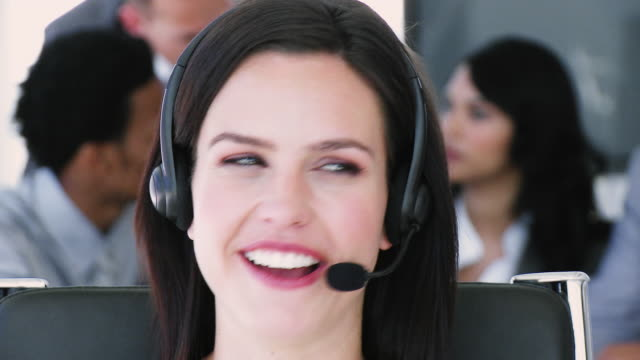cu female customer service representative at work, people in background / cape town, south africa - see other clips from this shoot 1790 stock videos & royalty-free footage